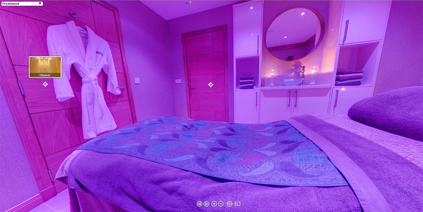 image of the inside of a Spa treatment room bathed in mellow purple light